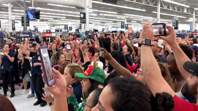 Shoppers watch as parranda celebration takes over Kissimmee