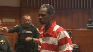 Mother of accused cop killer says son isn