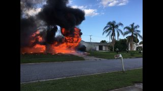 Firefighters battle large house fire in Rockledge