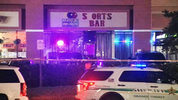 A man was killed and a security guard was injured during a shooting Monday morning outside a sport bar in Orange County, deputies said.