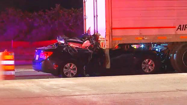 Man killed after car crashes into tractor-trailer in Orange