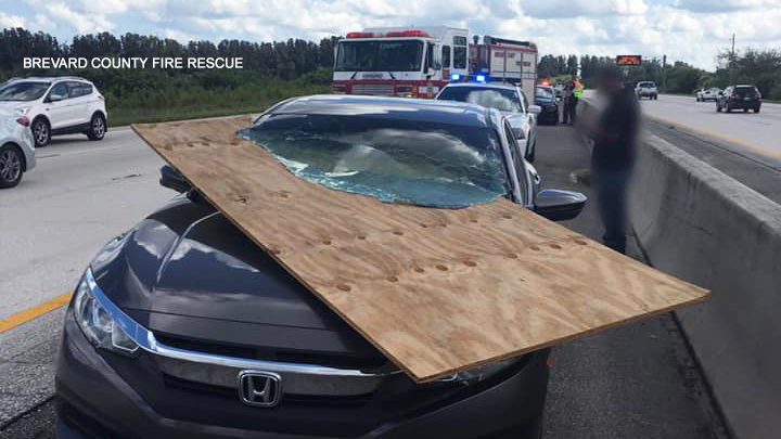 Plywood slices through woman's windshield on I-95 near Rockledge | WFTV