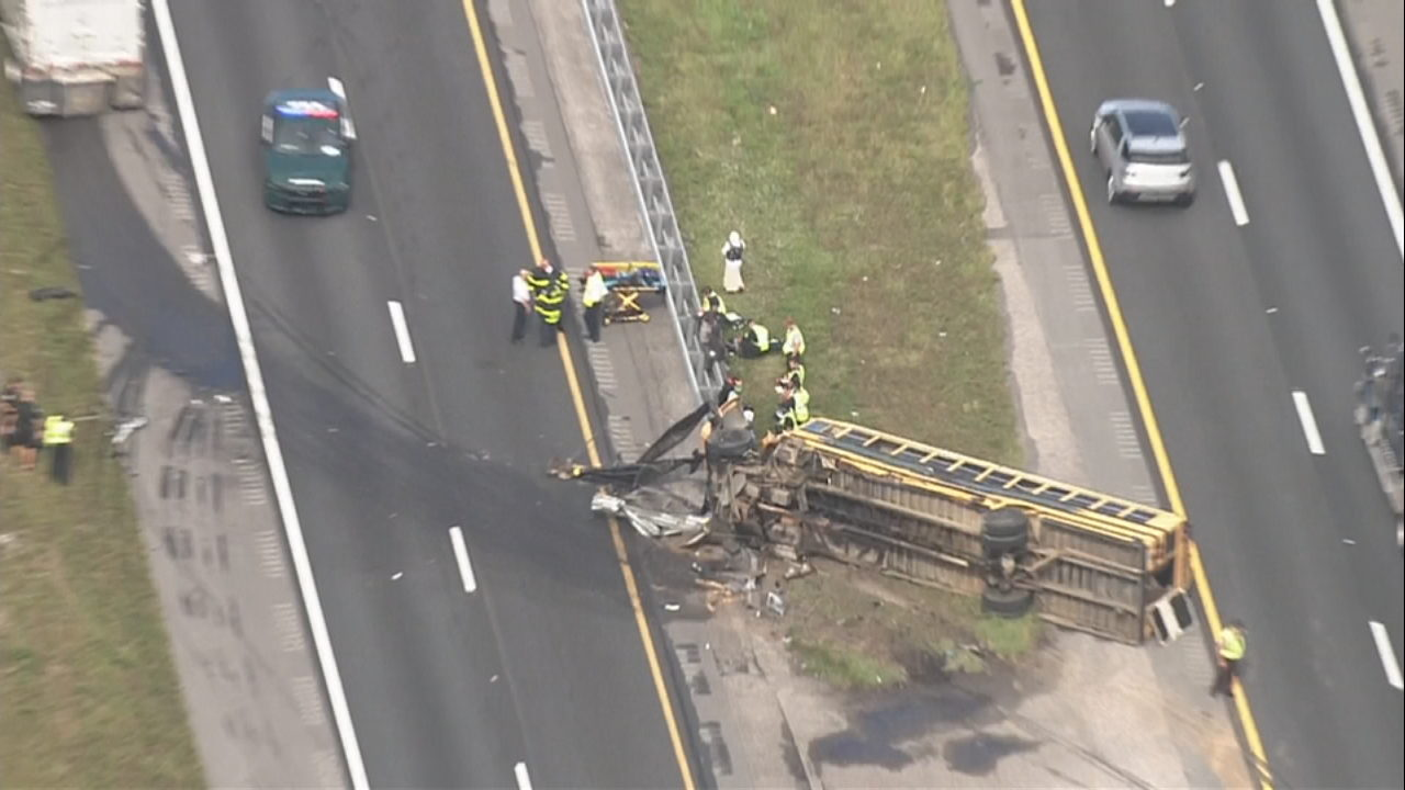 Turnpike reopens after crash involving school bus in St