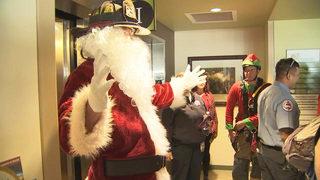 Santa, elves surprise patients at Florida Children
