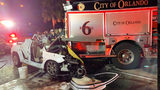 Officials said a car crashed into a fire truck as they were assisting another crash on SR-408.