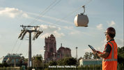 A photo from the Disney Parks blog shows an enclosed gondola cabin suspended in the air near Disney's Hollywood Studios.