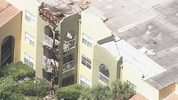 Firefighters battled a fire Tuesday at an apartment in Orange County, officials said.
