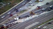 A tractor-trailer overturned Wednesday on Interstate 4 in Maitland, spilling its materials on the highway.