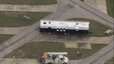 Wind damage in Polk County: trailer, RV, trees downed