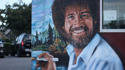 Muralist Jonas Never painted a mural of Central Florida native Bob Ross on the side of the Floyd's 99 Barbershop on Fairbanks Avenue in Winter Park this March.