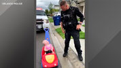 An adorable moment was caught on camera when an Orlando police officer pulled over his toddler's car.