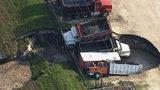 VIDEO: Massive holes swallow multiple trucks outside Orange County business, deputies say
