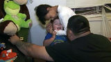 Raw video: Father, son reunited after police say biological mother abducted toddler at gunpoint